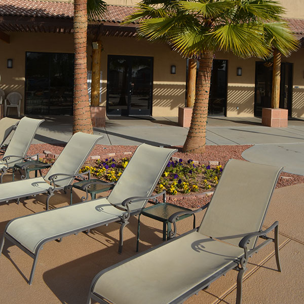 Lounge chairs along the pool