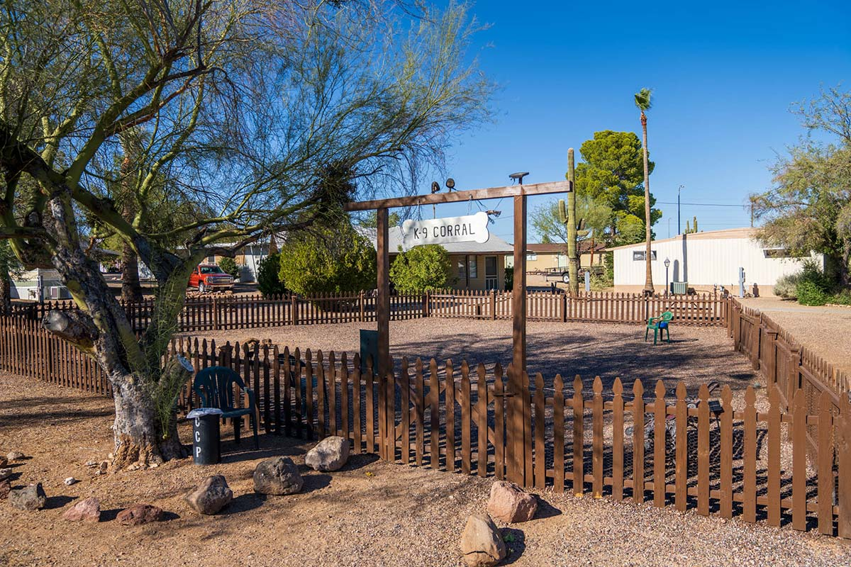Fenced in dog park at Country Club Mobile Home & RV Park