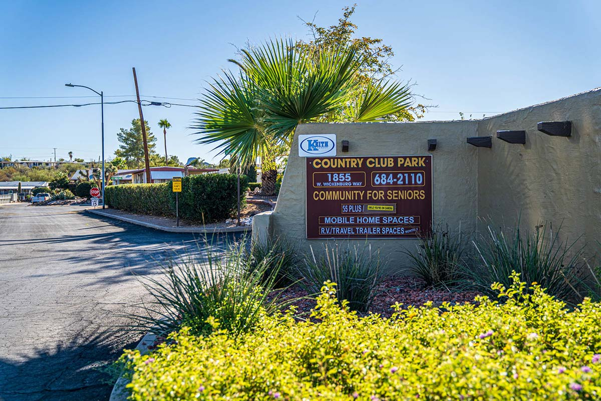 Entrance sign at Country Club Mobile Home & RV Park