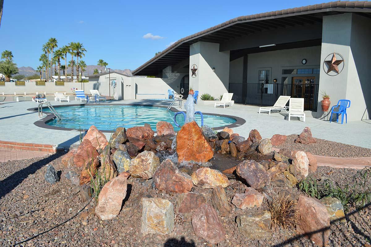 Water feature by El Dorado Mobile Estates & RV Park's pool