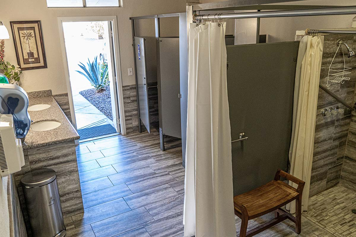 Full bathroom and shower area next to El Dorado Mobile Estates & RV Park's pool
