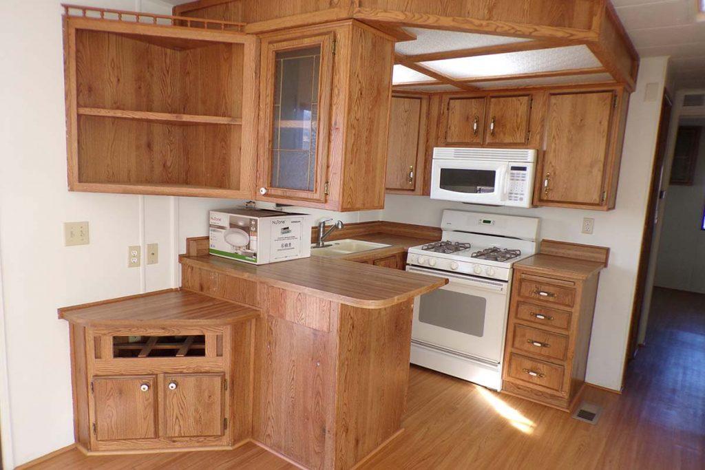 Houston Creek #3 open kitchen with white appliances