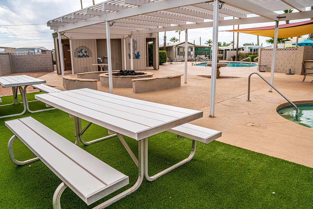 Pool, spa, fire-pit and sitting areas at Ironwood RV & Mobile Home Park