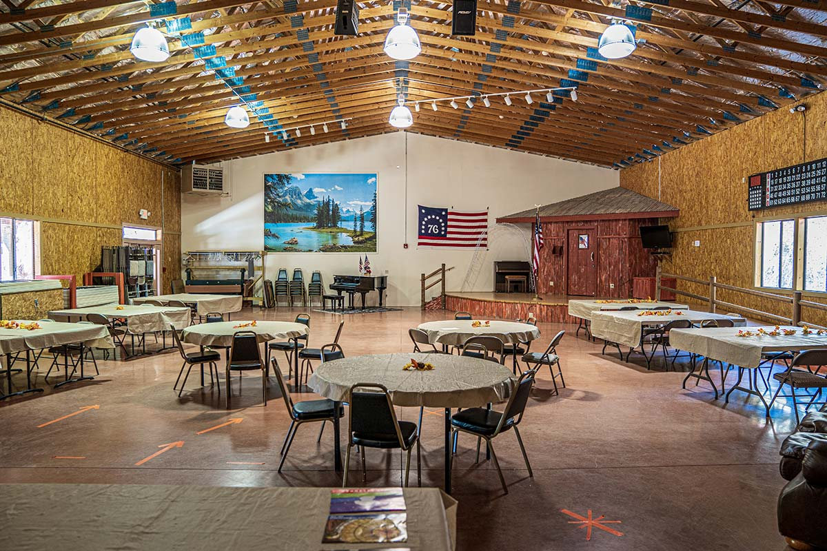 Large recreation hall with stage at Lamplighter RV Resort & Park