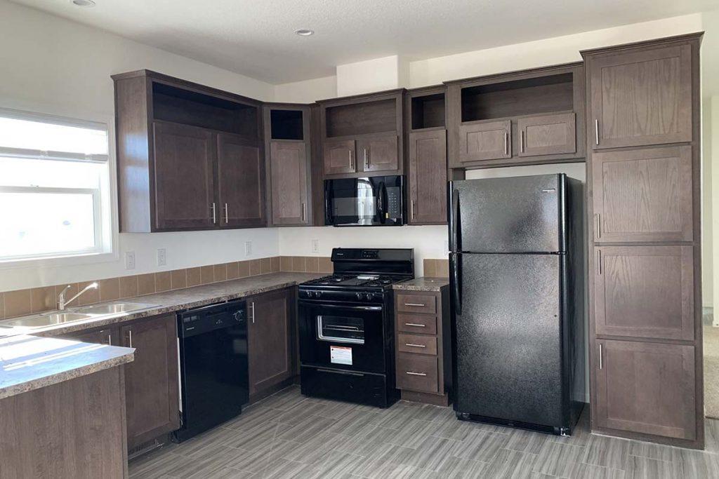 Meridian #142 kitchen with black appliances