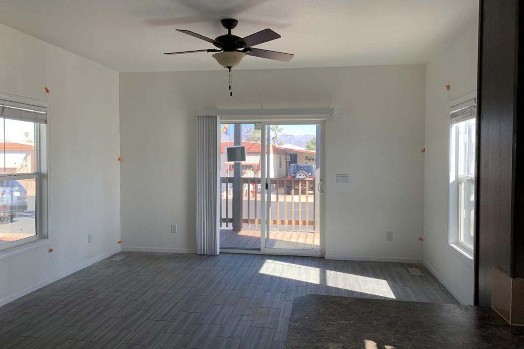 Meridian #142 living room area with sliding glass door