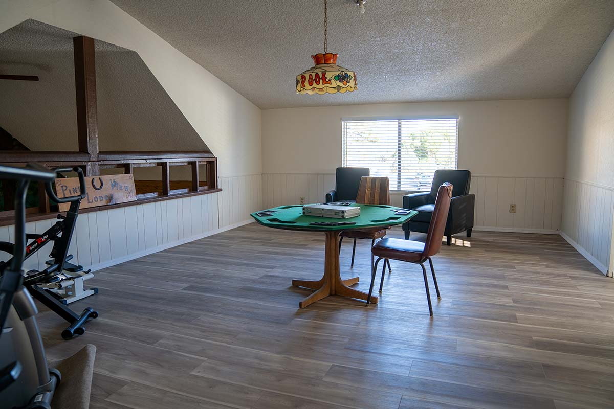 Lodge loft with card table, exercise equipment and sitting area