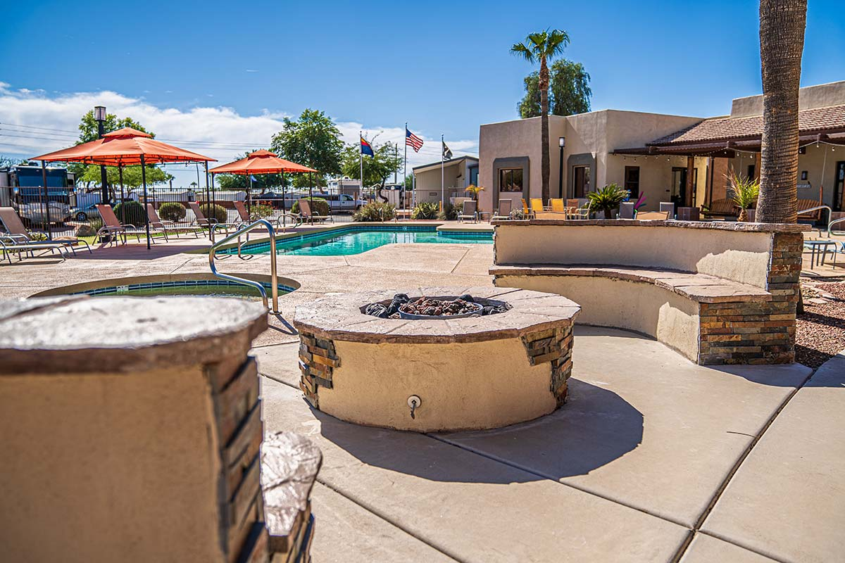 Gas fire-pit and sitting area looking over pool and spa at Shiprock RV Resort