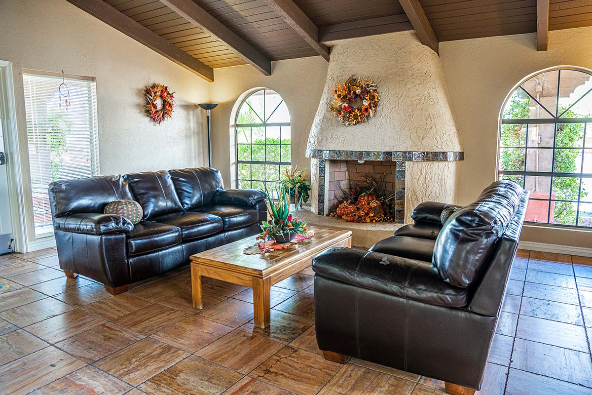 Couches by a fireplace at Superstition Lookout RV Resort's Clubhouse