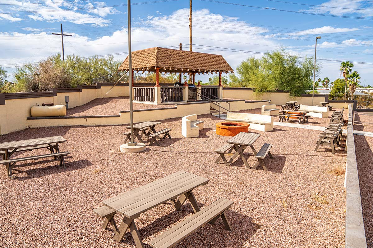 Picnic tables and fire-pit at Superstition Lookout RV Resort