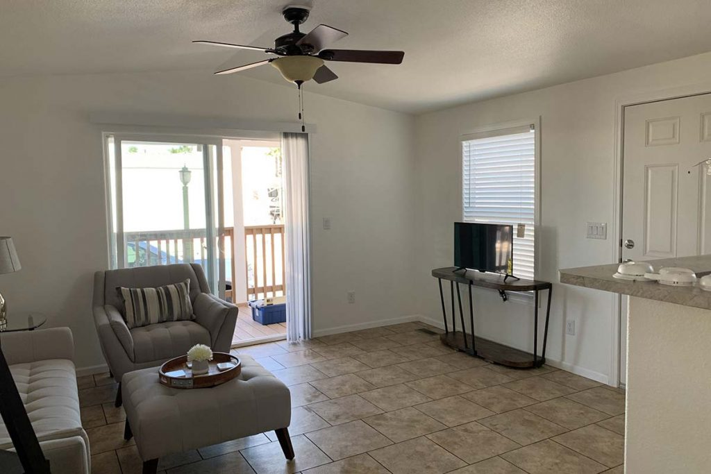 Superstition #145 living area with sliding glass door to front porch