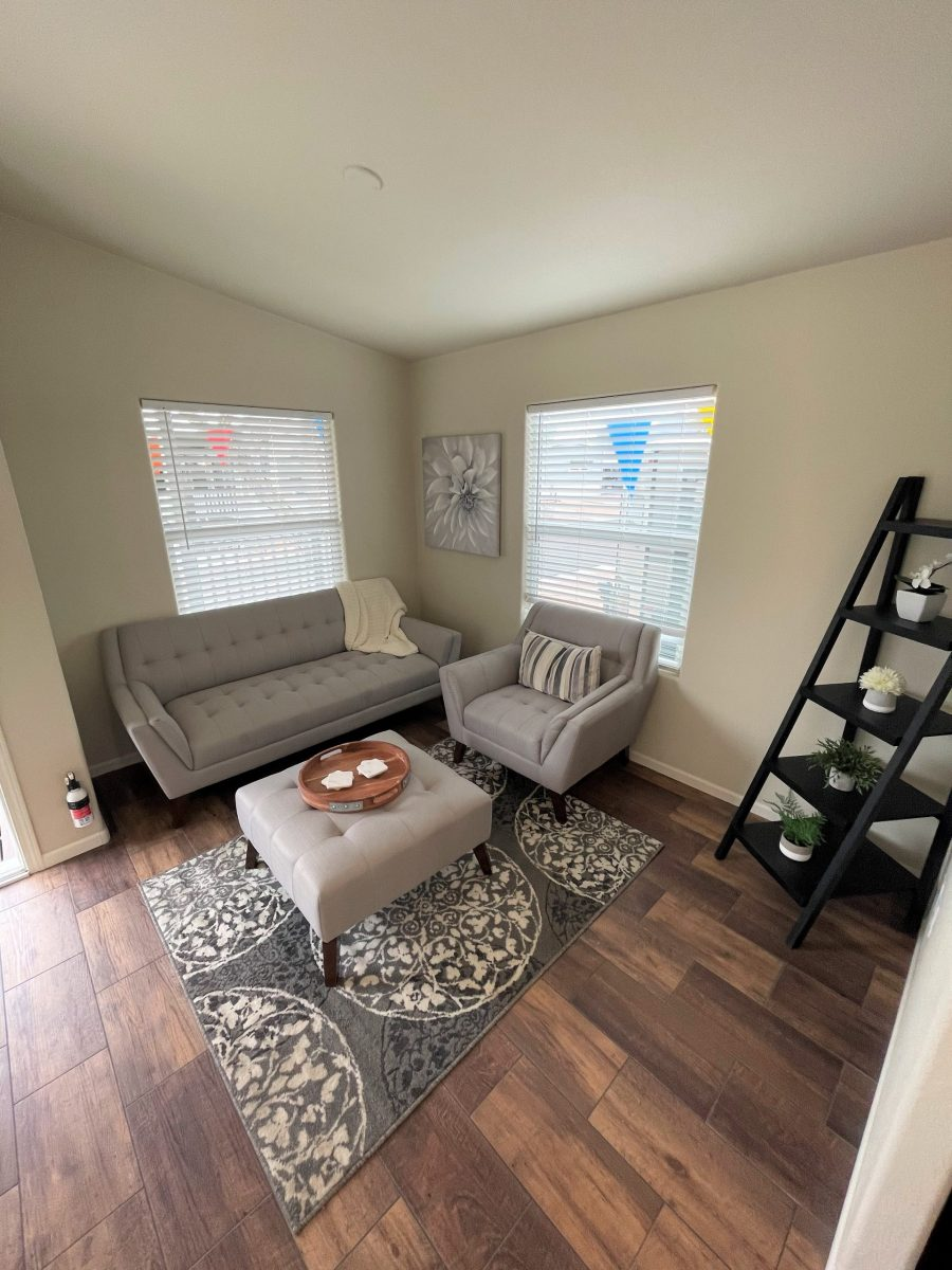 Furnished Living Room with brown wood-laminate flooring