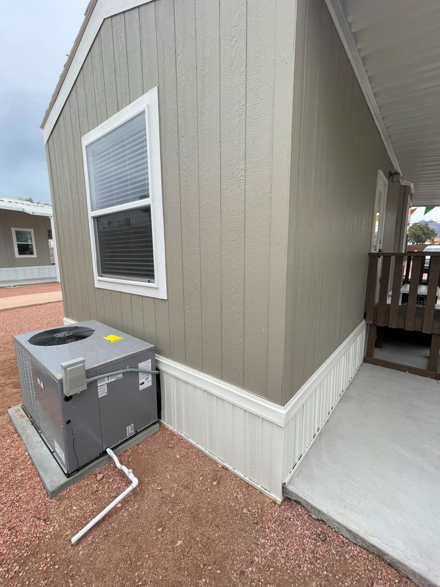AC unit attached to mobile home