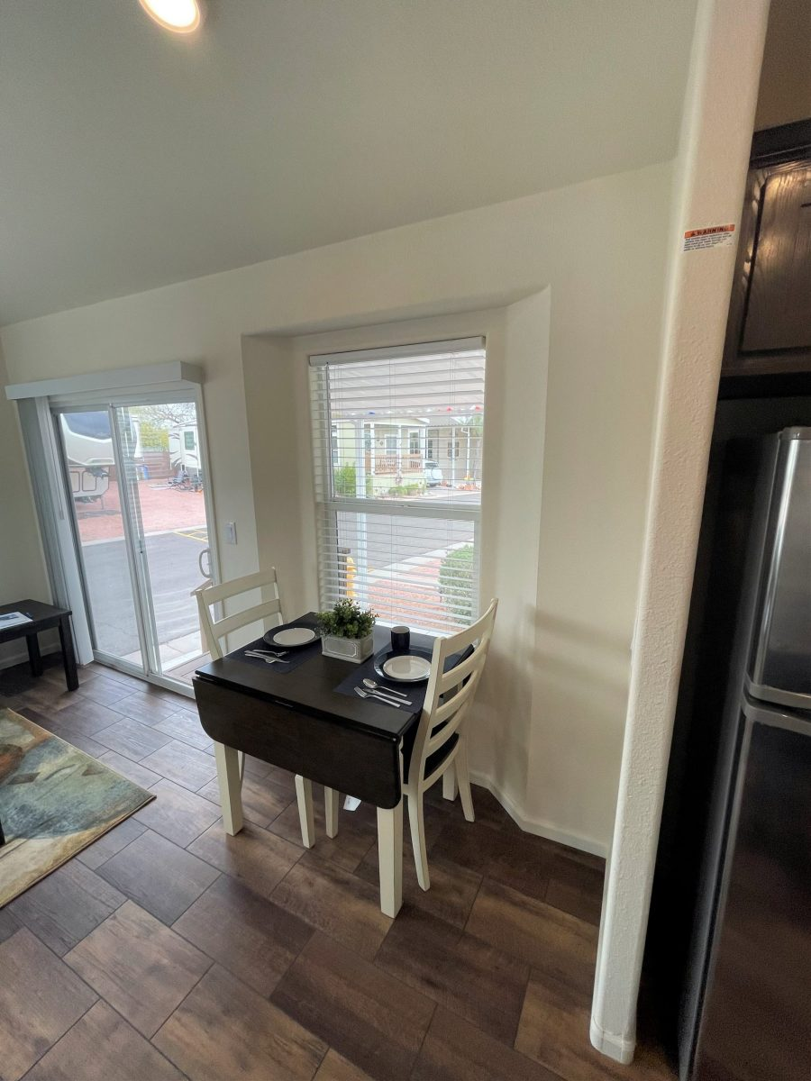 Small table in front of window near glass door, wood-laminate floors