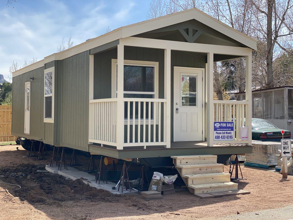 Manufactured home with deck windows side door