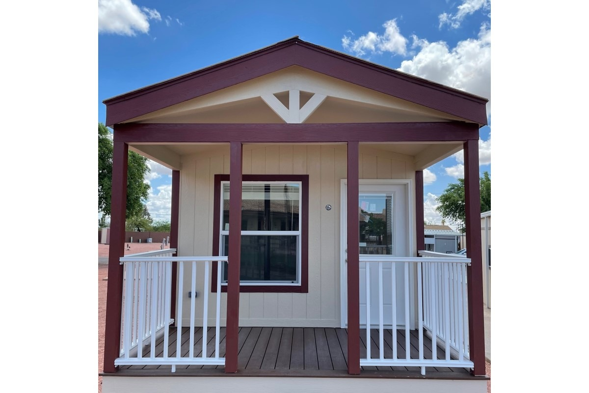 Park model home with porch, wood railing