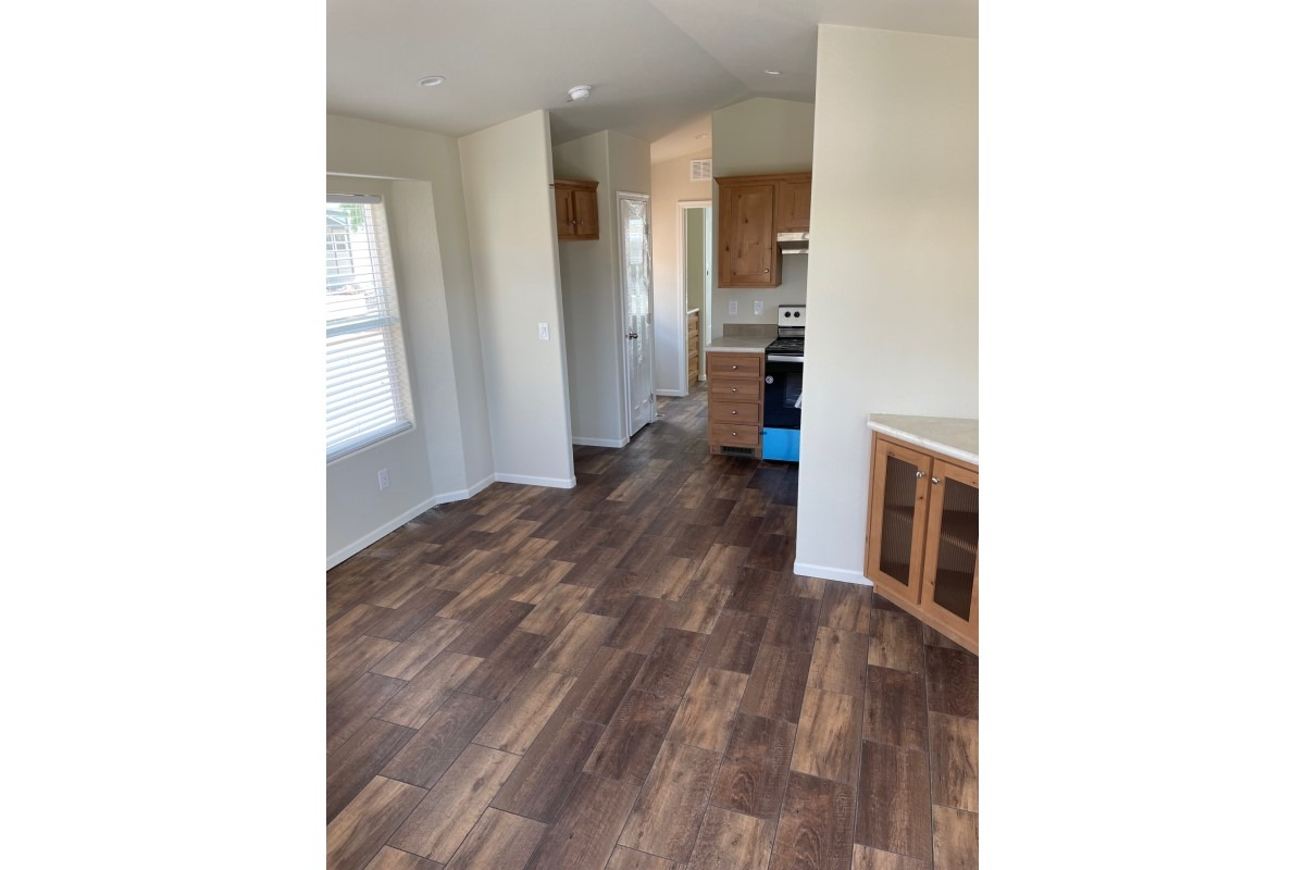 Hallway through kitchen, pantry and fridge area to left