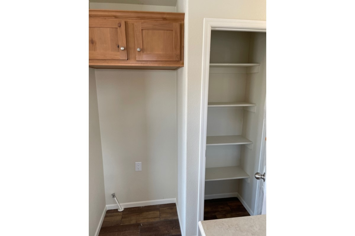 Kitchen Pantry and space for refrigerator with overhead cabinets